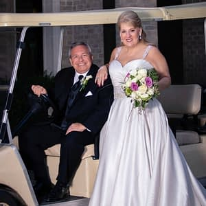 Mr and Mrs Gallagher wedding picture on a golf cart